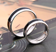 Coppia di anelli in acciaio e titanio
